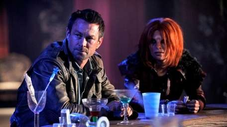 "Grant Bowler, left, and Stephanie Leonidas in ""Defiance"""