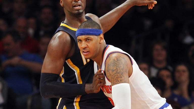 Carmelo Anthony of the Knicks battles for position