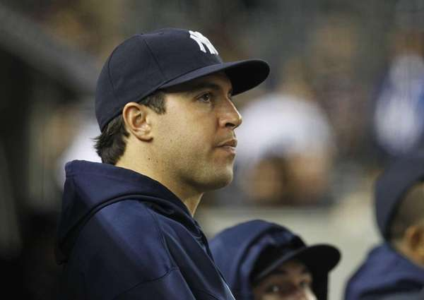 Mark Teixeira looks on from the bench during