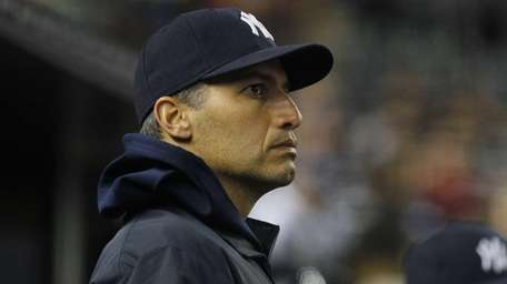 Andy Pettitte looks on from the bench during