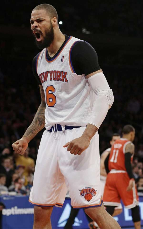 Tyson Chandler (6) reacts after dunking the ball