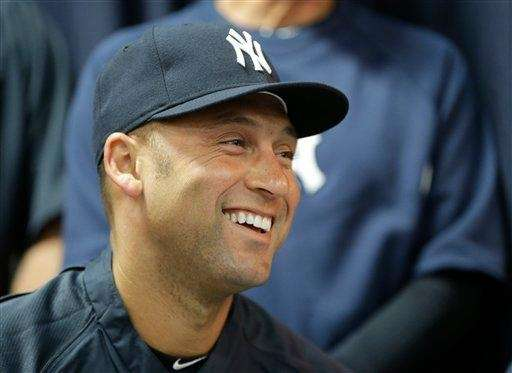Derek Jeter listens to pitcher Mariano Rivera announce