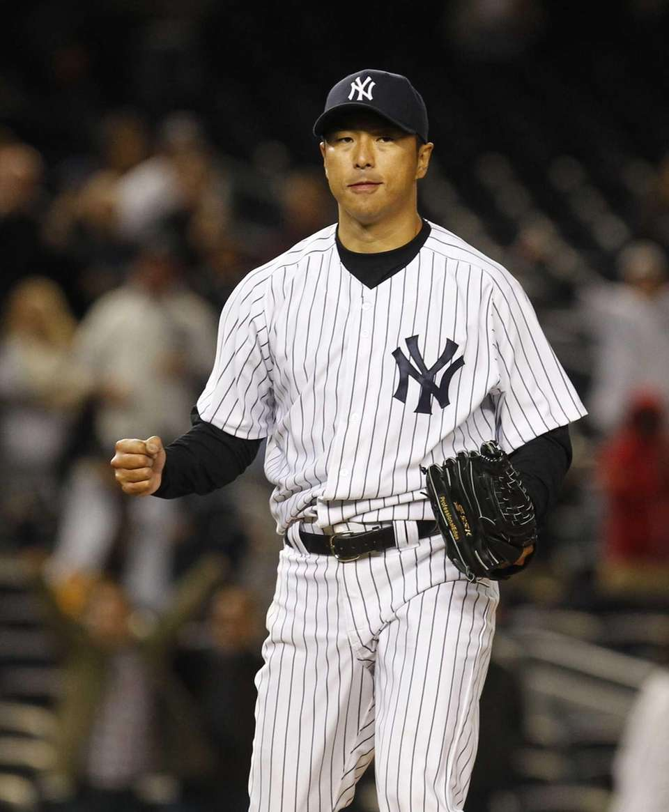 Hiroki Kuroda pumps his fist after pitching a