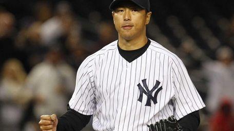 Hiroki Kuroda pumps his fist after pitching a