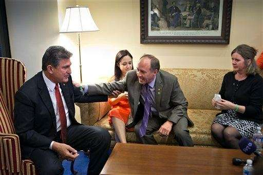 Sen. Joe Manchin, D-W.Va., left, meets in his