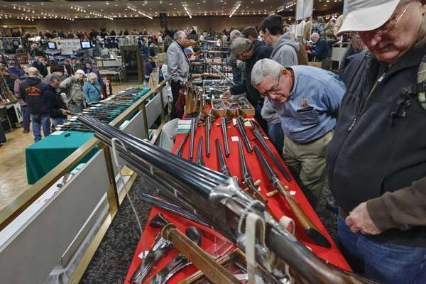 Gun enthusiasts gather during the annual New York