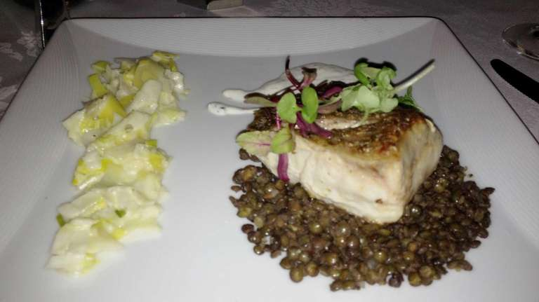 Roasted wild striped bass with French lentils, leeks