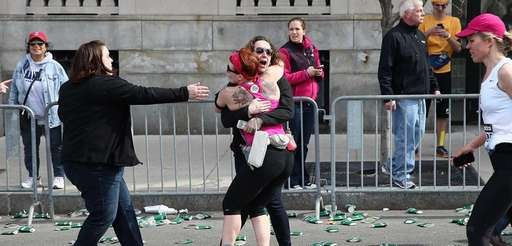 A runner embraces another woman on the marathon