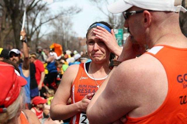 A runner reacts near the explosions during
