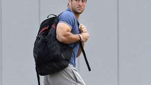 Jets quarterback Tim Tebow arrives on the first