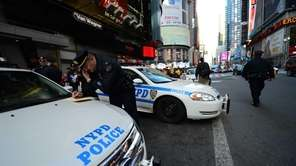 Police officers man their post at Times Square