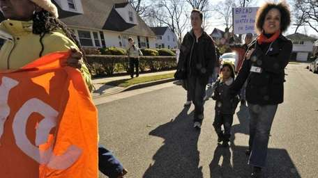 Elmont resident Mimi Pierre-Johnson, right, and her son,