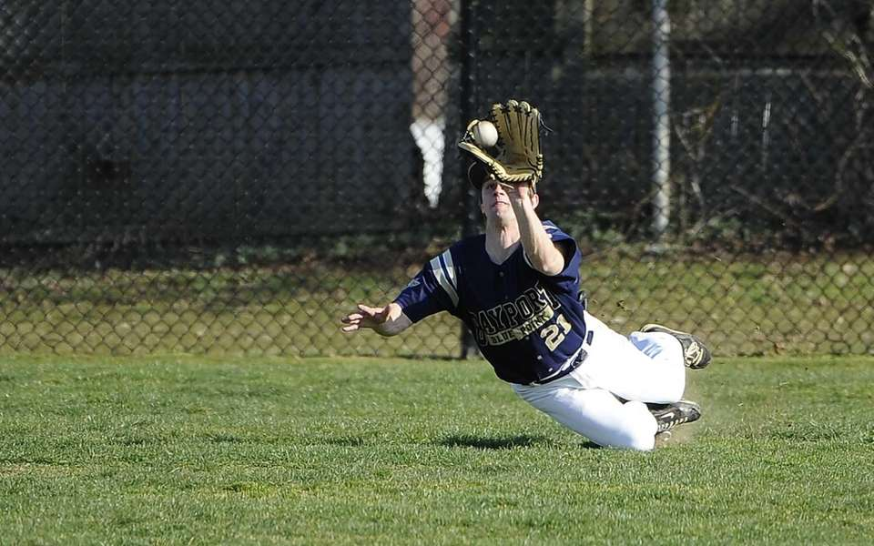 Bayport-Blue Point's Mike Alleigro makes the catch in