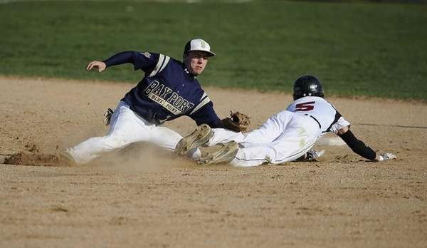 Bayport-Blue Point second baseman Matt White tags out