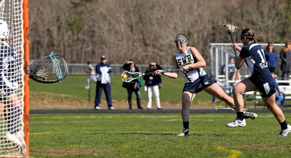 Shoreham's Shannon Rosati shoots and scores against Eastport.