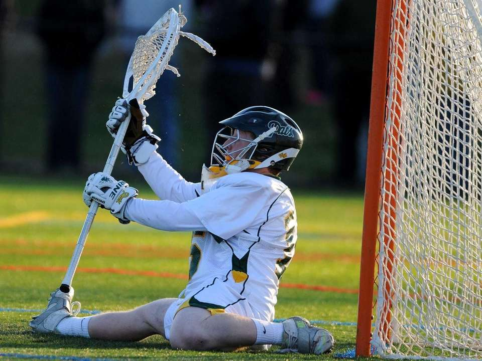 Ward Melville goalie Daniel Nemirov tries to make