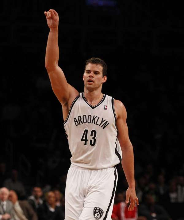Kris Humphries reacts after hitting a basket during