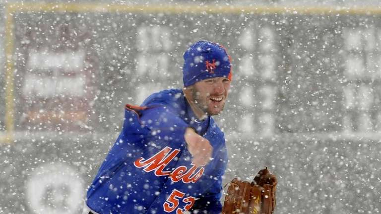 Jeremy Hefner throws in the snow before a