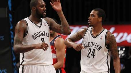 Andray Blatche celebrates with Kris Joseph after hitting
