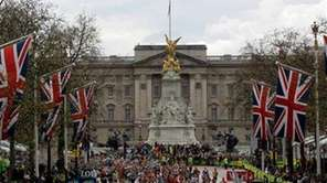 Runners in front of Buckingham Palace as they