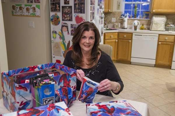Longtime Birthday Wishes volunteer Pat Vagianos assembles two