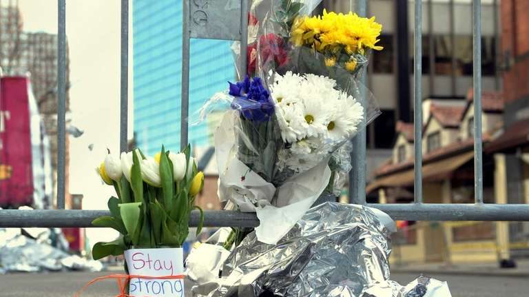 Flowers and a message are left on Newbury