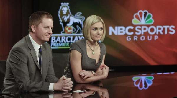 Arlo White, left, and Rebecca Lowe listen during