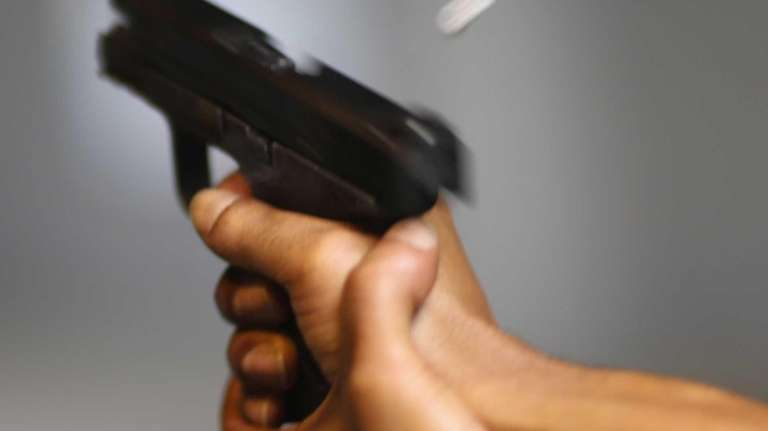 A handgun is used on the indoor firing
