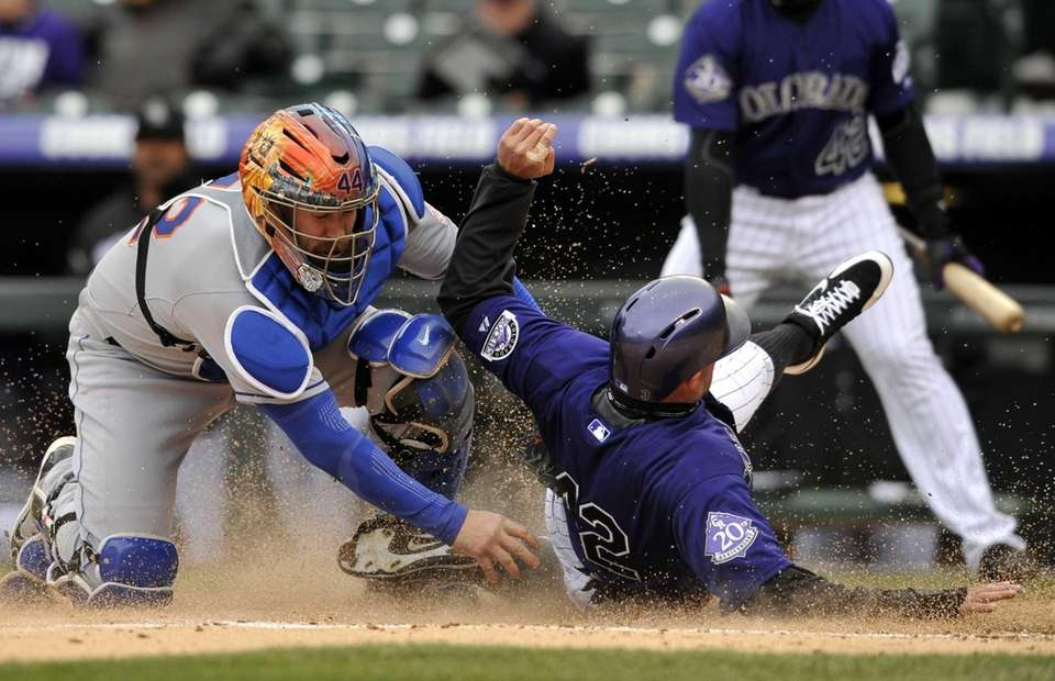 Colorado Rockies outfielder Michael Cuddyer, right, beats the