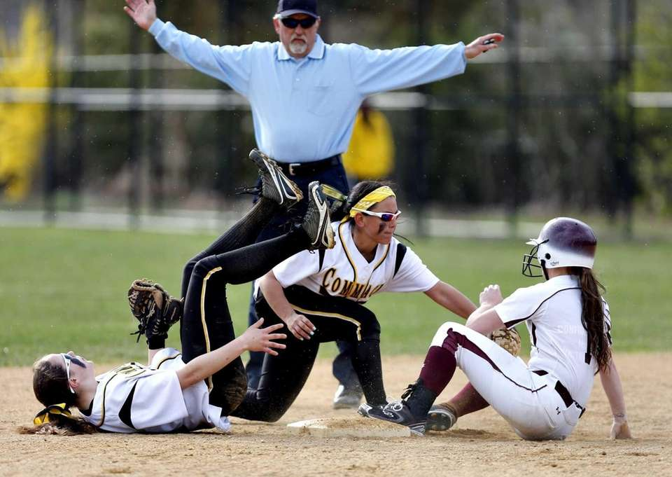 Commack's second baseman Jessica Lodato tags a sliding