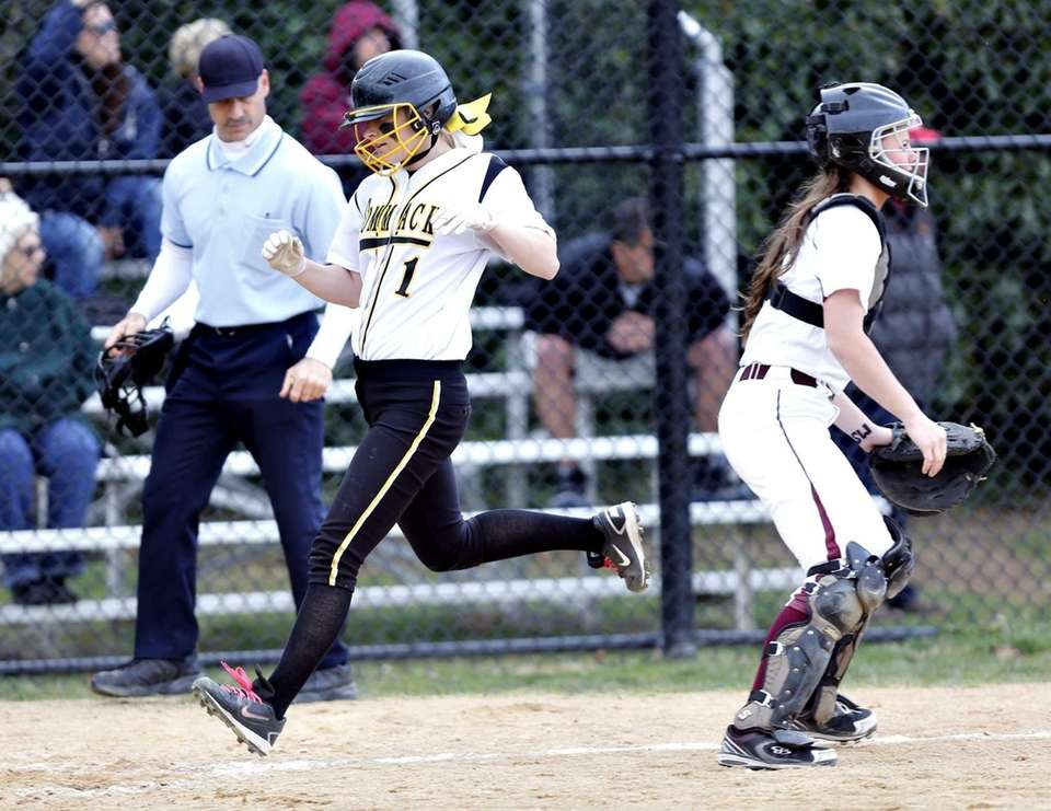 Commack's Kristen Andrews scores on a triple by