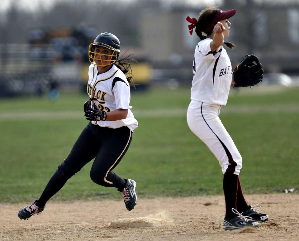 Commack's Jessica Lodato rounds second on a single