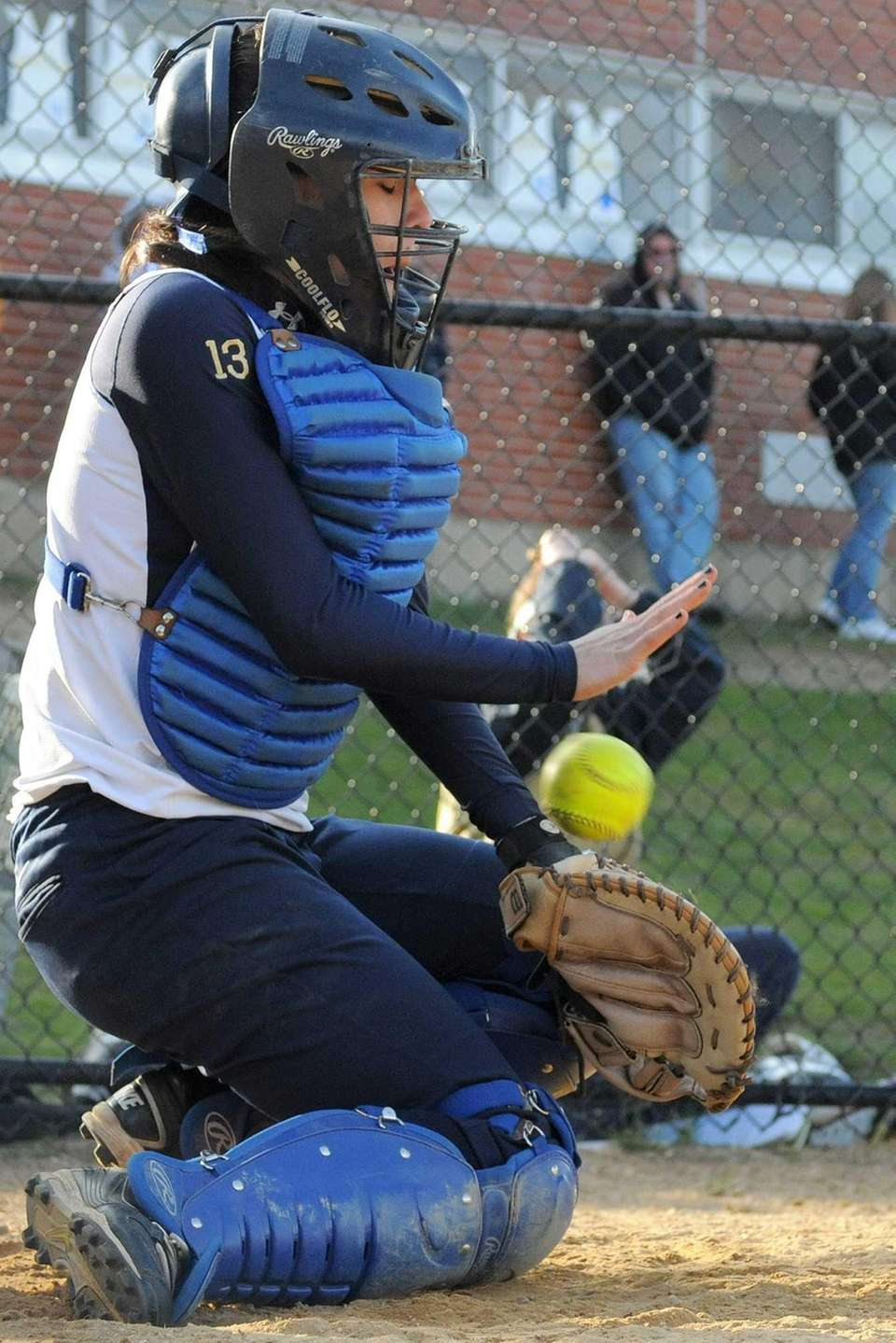 Baldwin catcher Michele Messina blocks a low pitch