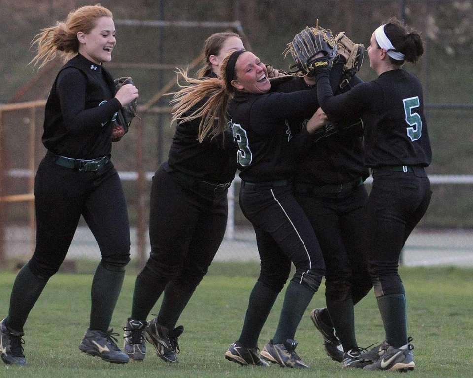 Farmingdale varsity softball teammates celebrate after their 14-11