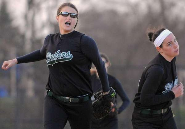 Farmingdale LF Jenna Crawford, left, reacts after recording