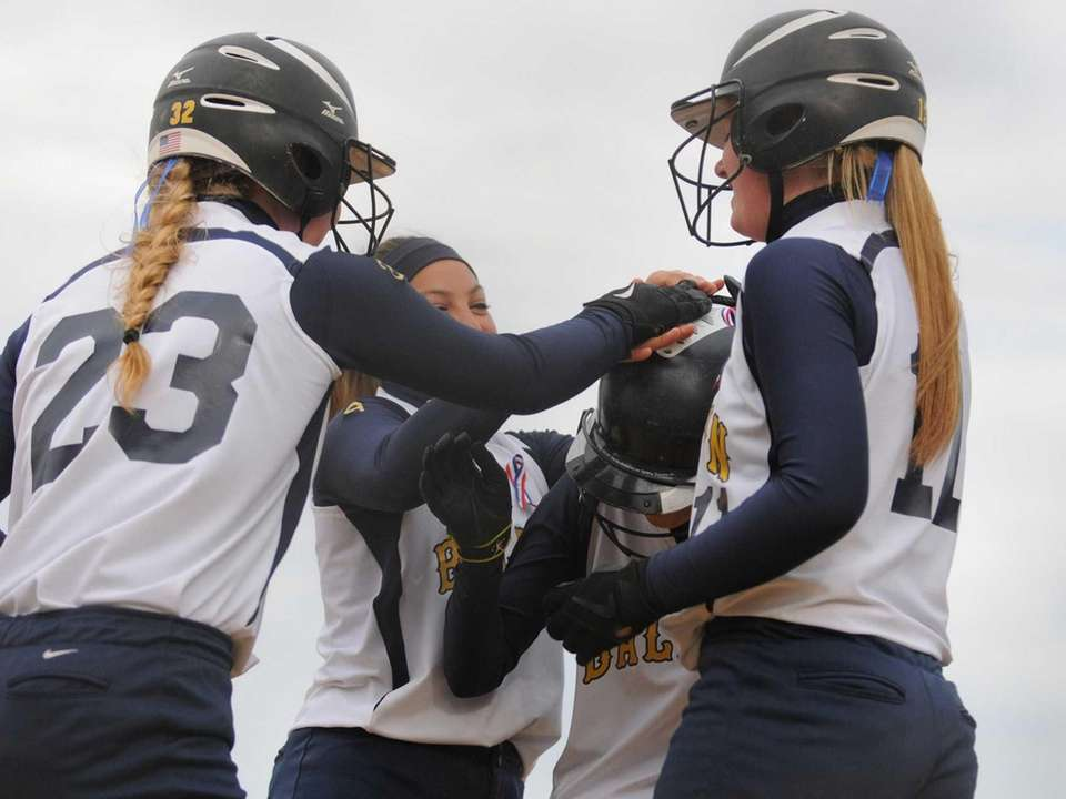 Baldwin teammates congratulate SS Jade Aponte, second from