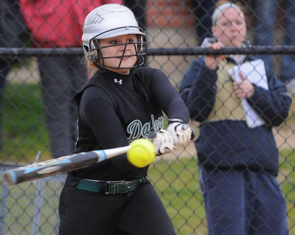 Farmingdale 3B Susie Doscher belts a triple during