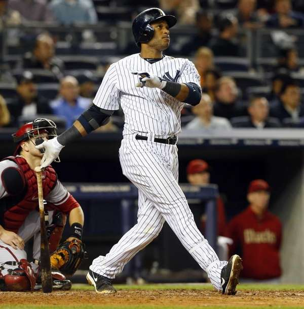 Robinson Cano of the Yankees follows through on