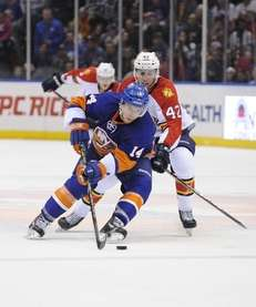 Thomas Hickey of the Islanders skates against Quinton
