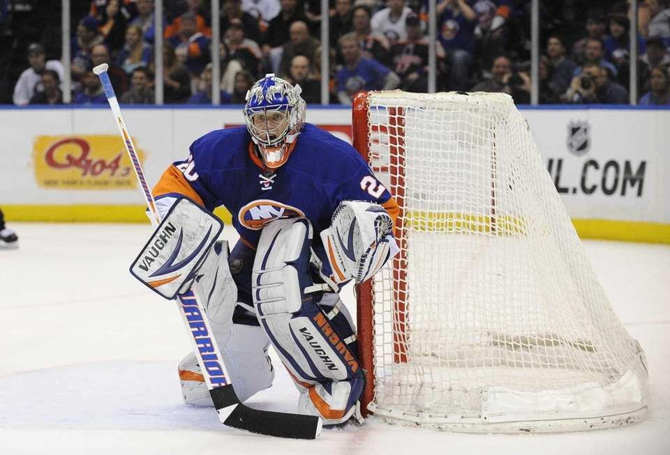 Goalie Evgeni Nabokov of the Islanders protects the