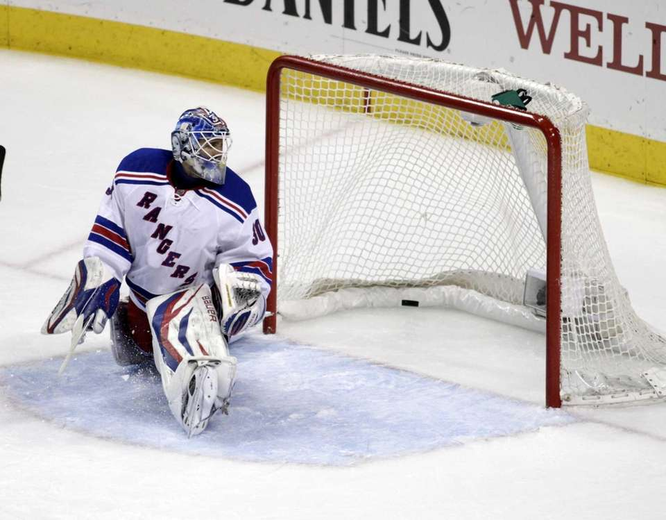 Henrik Lundqvist watches a goal by the Philadelphia