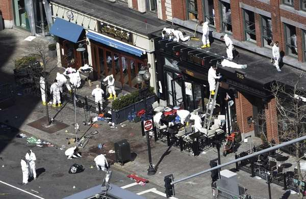 Investigators comb through the scene of the bombing