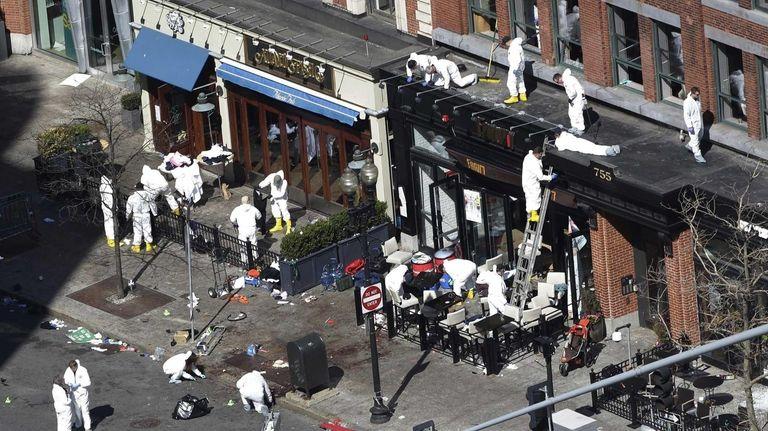 Investigators comb through the scene of the bombing