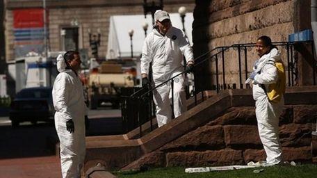 FBI members search for clues near the scene