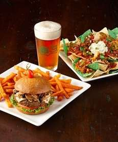 A mushroom Swiss burger and nachos at The