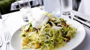A plate of frisee, endive, house cured pancetta,
