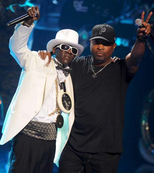 Rappers Flavor Flav, left, and Chuck D of