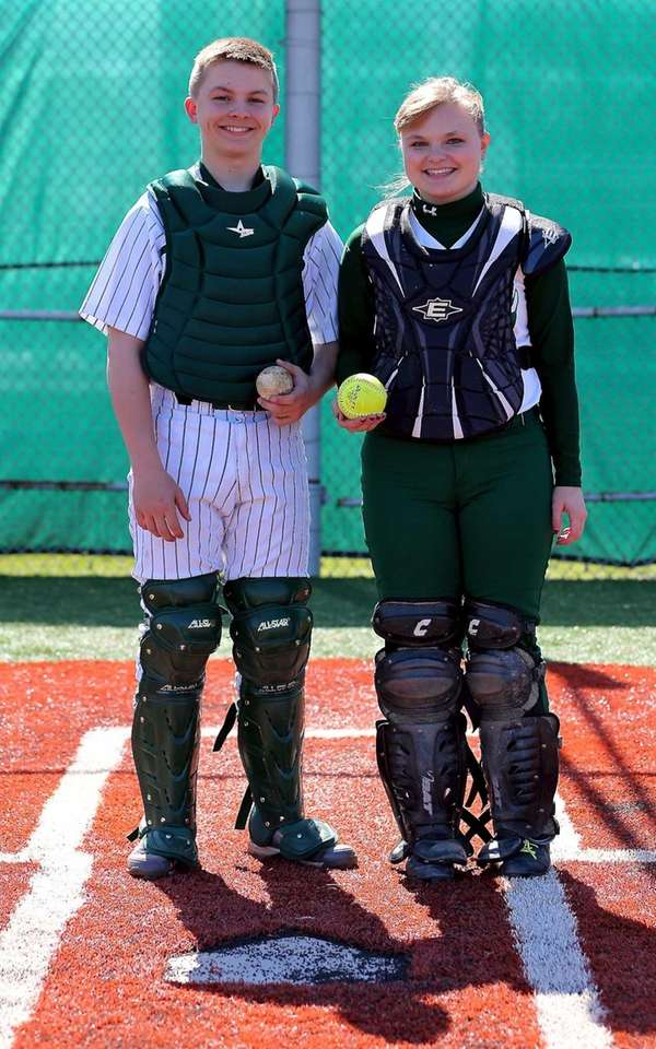 Holy Trinity softball catcher Katie Hogan with her