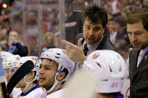 Jack Capuano talks with his team in the
