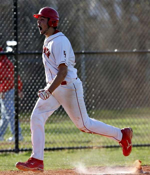 East Islip's Ken Rotunno runs home for the